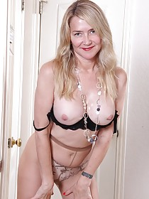 Blond-haired MILF in a dress showing off her beautiful body on the floor