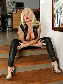 Leather pants blonde MILF slowly stripping in the living room