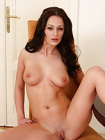Wavy-haired European brunette baring her immaculate pussy for you