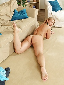 Shy-looking blonde MILF showing off her pussy and masturbating